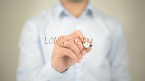 Long-Term , man writing on transparent screen Royalty Free Stock Photo