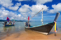 Long thai boat on sand beach Stock Image