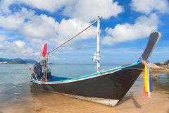 Long thai boat on sand beach Royalty Free Stock Photo
