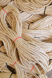 Long thick rope tied with red and black band for sale Royalty Free Stock Image