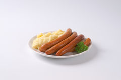 Long Thin Sausages With Mashed Potatoes Stock Photography