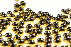 Long Thread of Plastic Golden Beads for Christmas Decorations stock image