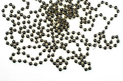 Long Thread of Plastic Golden Beads for Christmas Decorations royalty free stock photo