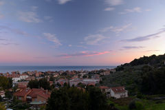 San Bartolomeo town at dusk. Long time exposure of San Bartolomeo al Mare town at dusk, viewed from above. Blurred motion effect on clouds Stock Photography