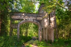 For a long time people lived here. Destroyed by time romantic entrance gates made of reinforced concrete 1914. Manor Zavetnoye. Novgorod Region, Russia Royalty Free Stock Photo
