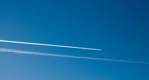 Long tracks of airplane in the blue sky. Two long tracks of airplane in the blue sky Stock Images