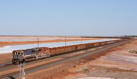 Long train. With iron-ore in the outback of australia Royalty Free Stock Image