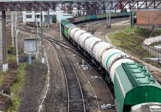A long train with cargo containers and wagons. Top view Stock Photos