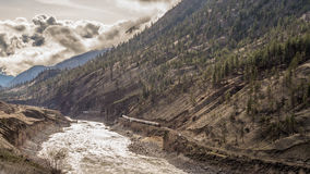 A Long Train heading West through the Fraser Canyon Royalty Free Stock Photos