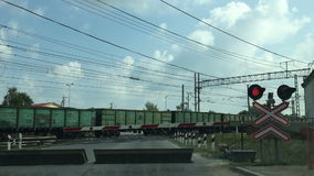 Long train passing through. The crossing timelapse stock video footage