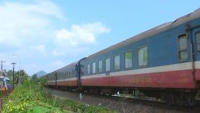 A long train rides on rails. Asia. tropics. day. heat stock video