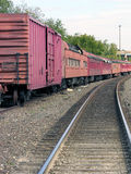 Long Train Runnin'. Long unused, antique railroad cars sit on side tracks displayed in the Guthrie, Oklahoma, trainyard they call home Royalty Free Stock Photos