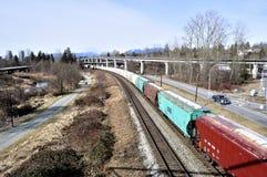 Long train transportation of cargoes Stock Photo