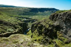 View of the valley and the winding gorge at the Glymur waterfall in Iceland stock photos