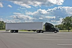 Long truck. Long cargo truck parking under blue sky Royalty Free Stock Photography