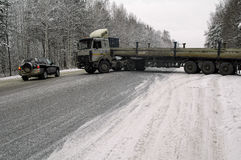 Long truck drifton the winter road Royalty Free Stock Photography