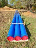 Long tube on ground. Colorful thick wall of plastic pipe stock image