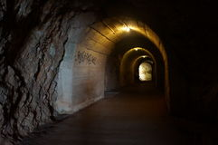Long tunnel in the rock for the passage to sea Royalty Free Stock Image