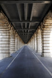Long tunnel under bridge Stock Images
