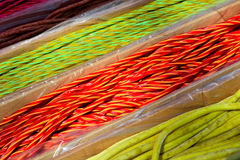 Long twisted candy of different colors Royalty Free Stock Image