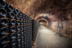 Long underground brick tunnel in the wine cellar Royalty Free Stock Photography