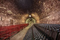 Long underground brick tunnel in the wine cellar Stock Images