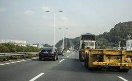 Long vehicle on modern highway, Shenzhen Stock Image