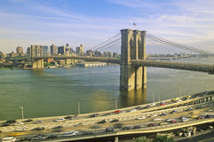 Long view of Brooklyn Bridge over East River to Brooklyn with FDR River, NY Royalty Free Stock Photography