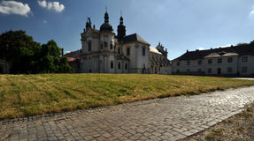 Long view of the building with monumental towers. And stone path to it Royalty Free Stock Image