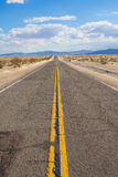 Long View of Desert Road Stock Photo