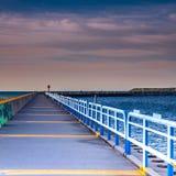 Long view of a pier on Lake Michigan. A long pier on Lake Michigan at sunrise stock photography