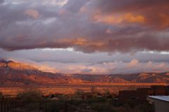 A long view of a sunset on the Sandia mountains Royalty Free Stock Photo