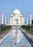 Long view on Taj Mahal mausoleum with reflection in canal at Ind Stock Image