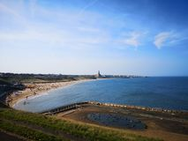 A long view of Tynemouth longsands and the old outdoor swimming pool royalty free stock photos