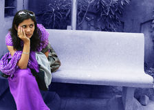 A long wait. A young Indian sitting on a bench waiting Stock Photo