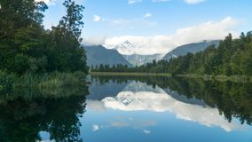 Lake Matheson with its reflection of the Mt. Cook peak in New Zealand. stock photos