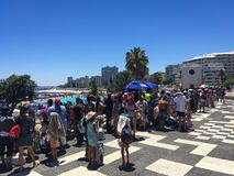 Long waiting lines for public events in hot weather. royalty free stock photo