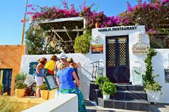 Tourists women exploring restaurant menu Santorini Stock Photos