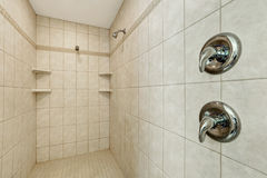 Long walk-in shower with two shower heads . Royalty Free Stock Images