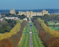 The Long Walk and Windsor Castle. Autumn colours on the Long Walk in Windsor Great Park in England with Windsor Castle in the background Royalty Free Stock Images