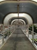 Long walking bridge. Image of a long hallway type bridge walk in Erbil royalty free stock photo