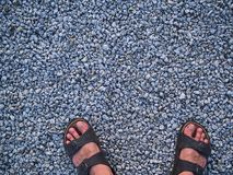 After long walking dirty foots. On the little blue rocks pattern stock photography