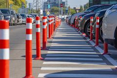 Pedestrian crossing surrounded by orange pillars royalty free stock photography