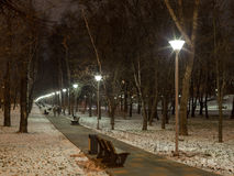 . Long walkway with street lamps. Evening lighting in winter urban. Long walkway with street lamps. City lights and illuminators. Russia, Moscow Royalty Free Stock Image
