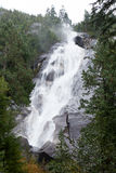 A long waterfall and cliffs, Shannon Falls, Squamish, BC Royalty Free Stock Photo