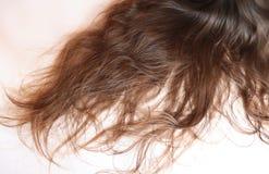 Long wavy brown hair on a teenage girl stock image