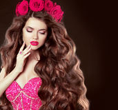 Long wavy hair. Beautiful brunette girl with sensual lips, in gl Stock Images