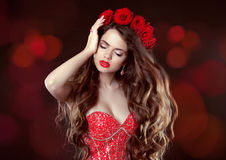 Long wavy Hair. Makeup. Beautiful Woman with roses. Beauty Portr Royalty Free Stock Images