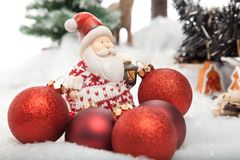 Long way to the Christmas Tree. Santa Claus is on the way with some red christmas baubles to decorate the christmas tree royalty free stock photography