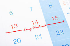 Long Weekend on calendar page. Concept image of a Calendar with the words Long Weekend to remind you an important appointment Stock Images